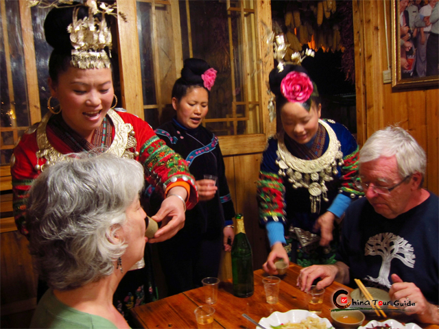 guizhou miao toasting to visitors
