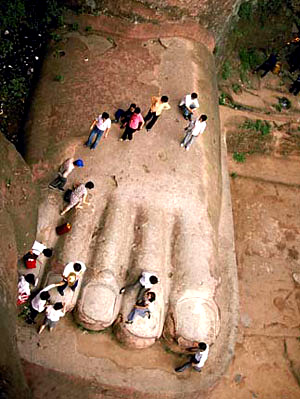 Many people stand on the foot of Leshan Giant Buddha.