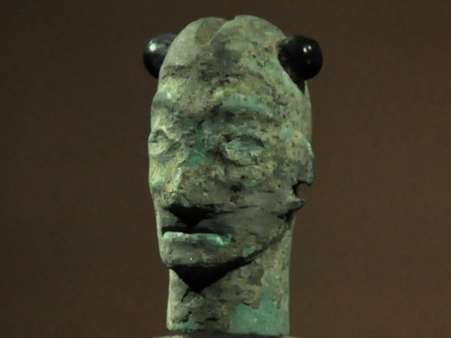 Bronze mask with horns
